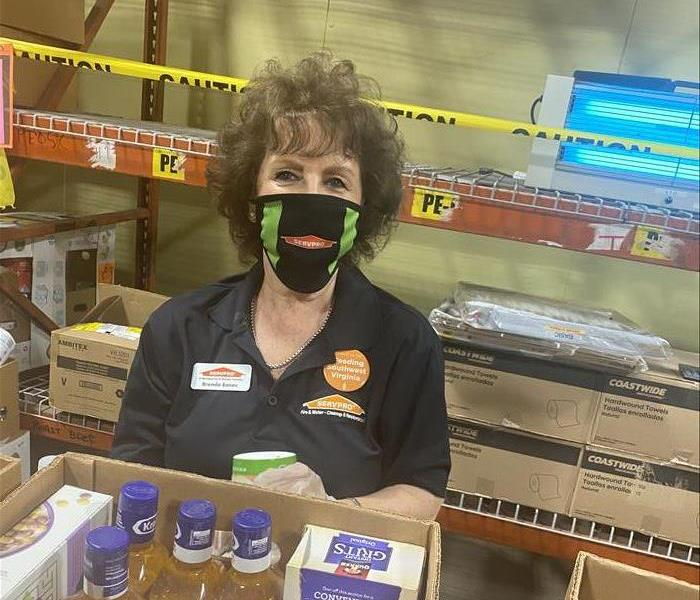 Woman with SERVPRO mask on